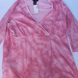 Pink and white top with handkerchief hem